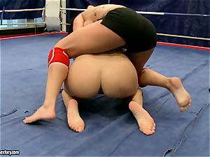Kerry Louise and Peaches lie on ring struggling