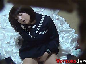 Uniformed chinese babe caresses