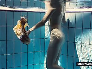 steaming gigantic titted teenage Lera swimming in the pool