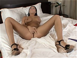 Pierced chinese London Keyes plays with her honeypot in couch