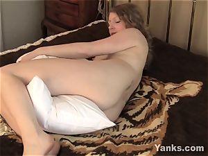 Emily displays enjoy to her pillow